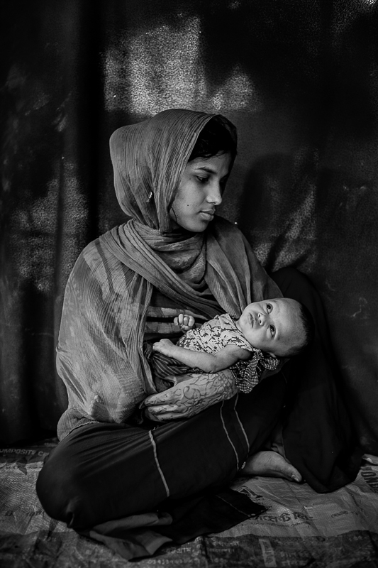 Rohingya mother Jaheda bibi from Nasapur, Myanmar with her 1 month old girl. She gave birth in the Kutupalong Rohingya refugee camp, Cox's Bazar.