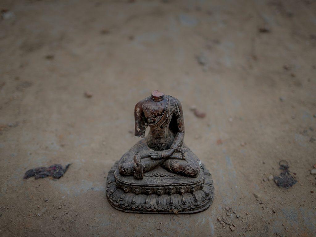 A broken Buddha statue in Swayambhunath Temple, Swayambhu, Kathmandu, Nepal. May 4, 2015.